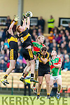 Ambrose O'Donovan and Johnny Buckley Dr Crokes in Action against Noel McGrath Loughmore-Castleiney in the Munster Senior Club Semi-Final at Crokes Ground, Lewis Road on Sunday