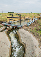 A head gate used to irrigate corn fields near the Xcel Energy Pawnee Generating Station in Fort Morgan, Colorado, Tuesday, July 21, 2015.<br /> <br /> Photo by Matt Nager