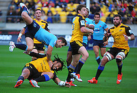 Ma'a Nonu gets his pass to Beauden Barrett in the tackle during the Super Rugby match between the Hurricanes and Waratahs at Westpac Stadium, Wellington, New Zealand on Saturday, 18 April 2015. Photo: Dave Lintott / lintottphoto.co.nz