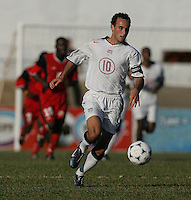 09 February, 2005. USMNT captain Landon Donovan brings the ball forward during the World Cup qualifier at Queen's Park Oval in Port of Spain, Trinidad and Tobago.  The USMNT defended Trinidad and Tobago 2-1.