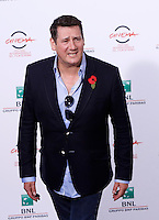 "Il frontman degli Spandau Ballet Tony Hadley posa durante un photocall per la presentazione del film documentario ""Soul Boys of the Western World - Spandau Ballet: il film"" al Festival Internazionale del Film di Roma, 20 ottobre 2014.<br /> Spandau Ballet frontman Tony Hadley poses for a photocall to present the documentary movie ""Soul Boys of the Western World"" during the international Rome Film Festival at Rome's Auditorium, 20 October 2014.<br /> UPDATE IMAGES PRESS/Riccardo De Luca"