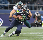 Seattle Seahawks quarterback Russell Wilson (3) scrambles before being taken down by Philadelphia Eagles Philadelphia Eagles defensive end Connor Barwin (98) at CenturyLink Field in Seattle, Washington on November 20, 2016.  Seahawks beat the Eagles 26-15.  ©2016. Jim Bryant Photo. All Rights Reserved.