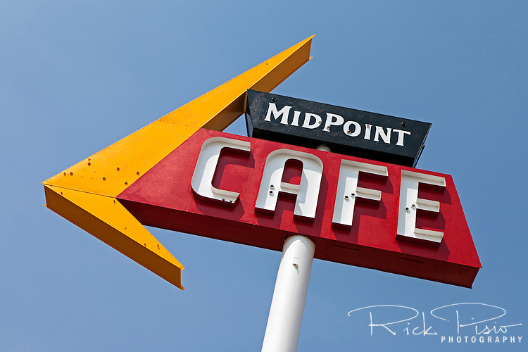 The freshly painted sign for the Midpoint Cafe along Route 66 in Adrian, Texas waits for its neon tubes.