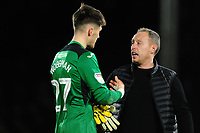 Freddie Woodman of Swansea City speaks with Steve Cooper Head Coach of Swansea City at full time during the Sky Bet Championship match between Fulham and Swansea City at Craven Cottage on February 26, 2020 in London, England. (Photo by Athena Pictures/Getty Images)