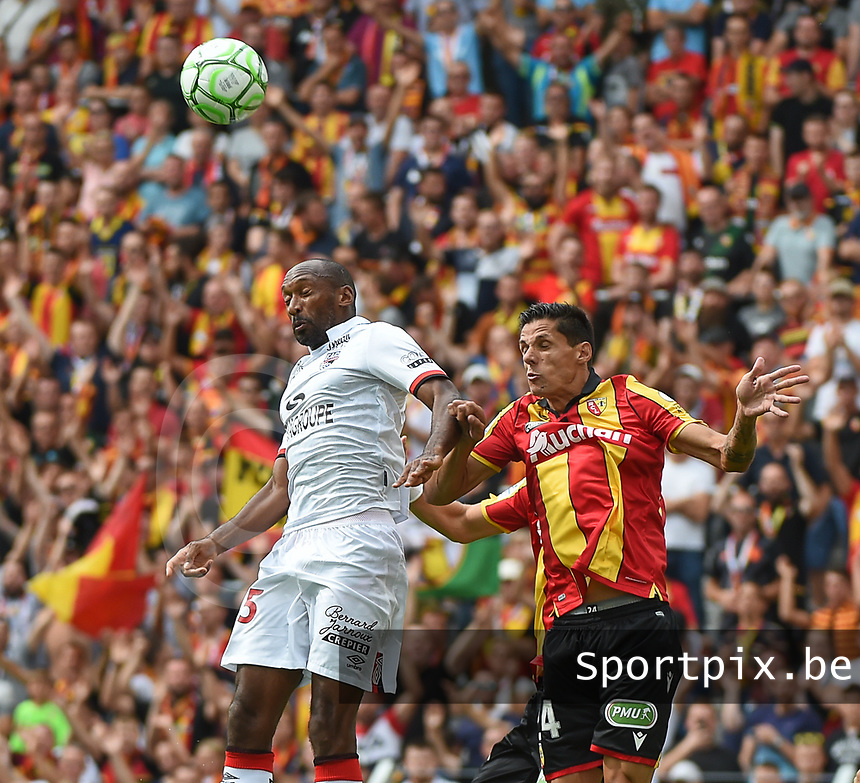 20190803 - LENS , FRANCE : Lens' Florian Sotoca (R) and Guingamp's Jeremy Sorbon (L) pictured during the soccer match between Racing Club de LENS and En Avant Guingamp , on the second matchday in the French Dominos pizza Ligue 2 at the Stade Bollaert Delelis stadium , Lens . Saturday 3 th August 2019 . PHOTO DIRK VUYLSTEKE | SPORTPIX.BE