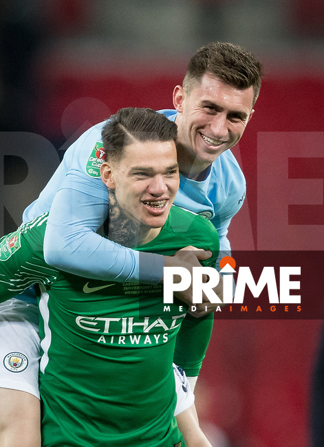 Goalkeeper Ederson of Man City & Aymeric Laporte of Man City at full time during the Carabao Cup FINAL match between Arsenal and Manchester City at Wembley Stadium, London, England on 25 February 2018. Photo by Andy Rowland.