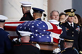 Former President George W. Bush watches as the flag-draped casket of his father, former President George H.W. Bush is carried by a joint services military honor guard to lie in state in the rotunda of the U.S. Capitol, Monday, Dec. 3, 2018, in Washington. (AP Photo/Alex Brandon, Pool)