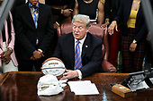 United States President Donald J. Trump accepts an autographed basketball as he welcomes the 2019 NCAA Division I Women's Basketball National Champions, the Baylor Lady Bears, in the Oval Office of the White House on April 29, 2019 in Washington, DC. <br /> Credit: Oliver Contreras / Pool via CNP