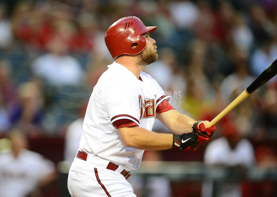 Apr. 17, 2012; Phoenix, AZ, USA; Arizona Diamondbacks outfielder Jason Kubel hits an RBI double in the first inning against the Pittsburgh Pirates at Chase Field.Mandatory Credit: Mark J. Rebilas-