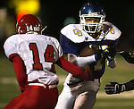 SIOUX FALLS, SD - OCTOBER 2:  Kelby Tague #17 of O'Gorman cuts back as Derrik Nelson #14 of Yankton defends in the first quarter of their game Friday night at O'Gorman. (Photo by Dave Eggen/Inertia).