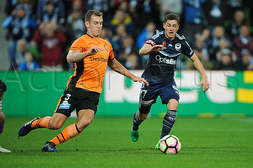 30th April 2017, AAMI Park, Melbourne, Australia; Hyundai A-League Football; Melbourne Victory versus Brisbane Roar FC; Luke De Vere of the Brisbane Roar and Marcus Rojas of the Melbourne Victory look towards the ball during the second half