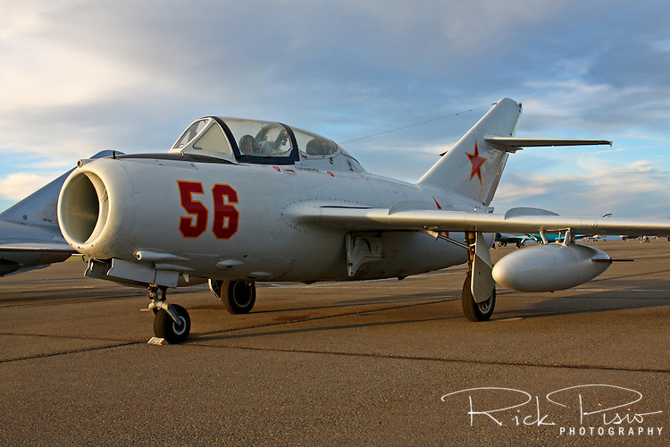 A trainer variant of the Mig 17 sits on the ramp at sunset. The Mig was used by many countries throughout the the world from the 1950's through the 1960's.