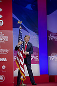 U.S. President Donald Trump hugs the U.S. flag during CPAC 2019 on March 02, 2019 in Washington, DC. The American Conservative Union hosts the annual Conservative Political Action Conference to discuss conservative agenda. <br /> Credit: Tasos Katopodis / Pool via CNP