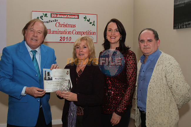 Lily Fallon accepts her award for third prize in the Drogheda Category from judges Frank Godfrey, Caroline Kavanagh and Thos Caffrey at the Christmas Illumination Awards in the d Hotel...(Photo credit should read Jenny Matthews/www.newsfile.ie)....This Picture has been sent you under the conditions enclosed by:.Newsfile Ltd..The Studio,.Millmount Abbey,.Drogheda,.Co Meath..Ireland..Tel: +353(0)41-9871240.Fax: +353(0)41-9871260.GSM: +353(0)86-2500958.email: pictures@newsfile.ie.www.newsfile.ie.