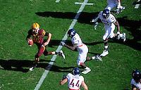 Nov. 28, 2009; Tempe, AZ, USA; Arizona State Sun Devils quarterback (10) Samson Szakacsy is pursued by Arizona Wildcats linebacker (15) Xavier Kelley at Sun Devil Stadium. Arizona defeated Arizona State 20-17. Mandatory Credit: Mark J. Rebilas-