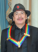 Musician and songwriter Carlos Santana waits to pose for a group photo with the other four recipients of the 2013 Kennedy Center Honors following a dinner hosted by United States Secretary of State John F. Kerry at the U.S. Department of State in Washington, D.C. on Saturday, December 1, 2013.  The 2013 honorees are opera singer Martina Arroyo; pianist, keyboardist, bandleader and composer Herbie Hancock; pianist, singer and songwriter Billy Joel; actress Shirley MacLaine; and musician and songwriter Carlos Santana.<br /> Credit: Ron Sachs / CNP