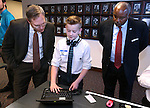 Intel education specialists Gregg Descheemaeker, left, and Darrell Stewart talk with Carson Middle School eighth-grader Ryan Maw during Digital Learning Day at the Legislative Building in Carson City, Nev., on Thursday, Feb. 5, 2015. Students from several Nevada schools talked with lawmakers and lobbyists about the Nevada Ready initative and the role technology in learning.  <br /> Photo by Cathleen Allison