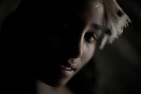 Agare', 14 years old, escaped three years before from her village where she was sold into marriage when she was 8 years old. She is portrayed in the shack where she works as a commercial sex worker in the center of the city of Bahir Dar, a commercial hub in the Northern Amhara region of Ethiopia. ..While in decline, early child marriage is still widely spread in rural areas of Ethiopia where families sell their daughters into marriage at ages as young as 5 years old...Names of subjects have been fictionalized and specific locations have been omitted to protect the identities of the children portrayed in the story.