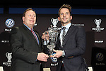 05 December 2013: Mike Magee (right) poses with the MLS MVP Trophy and Volkswagen executive Clark Campbell (left). Major League Soccer held a press conference announcing Mike Magee, of the Chicago Fire as the winner of the 2013 MLS Most Valuable Player award at the Three Points Club in Kansas City, Missouri.