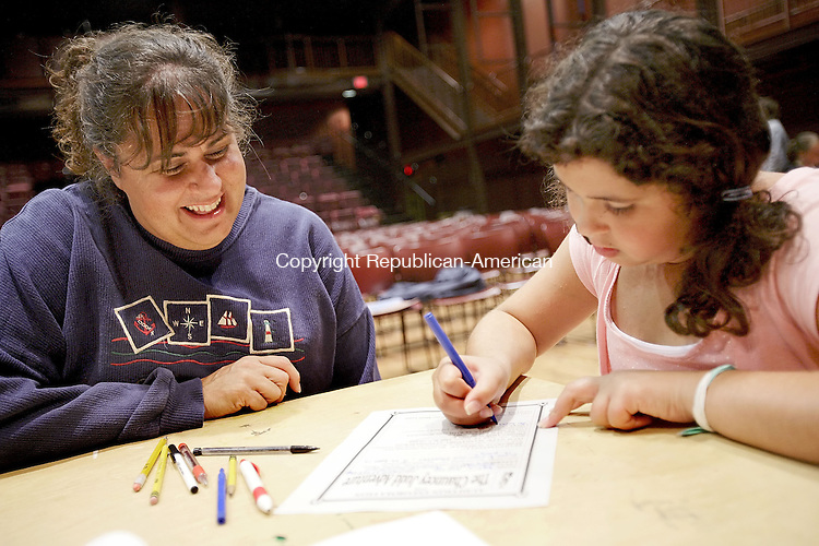 """MIDDLEBURY, CT-- 23 July 2007--07237TJ03- Jolene Anello, left, from Middlebury, Conn., laughs while helping her daughter, Katia, 9, fill out an application to audition for Middlebury's bicentennial play, """"The Chauncey Judd Adventure,"""" at the Westover School in Middlebury on Monday, July 23, 2007. T.J. Kirkpatrick / Republican-American"""