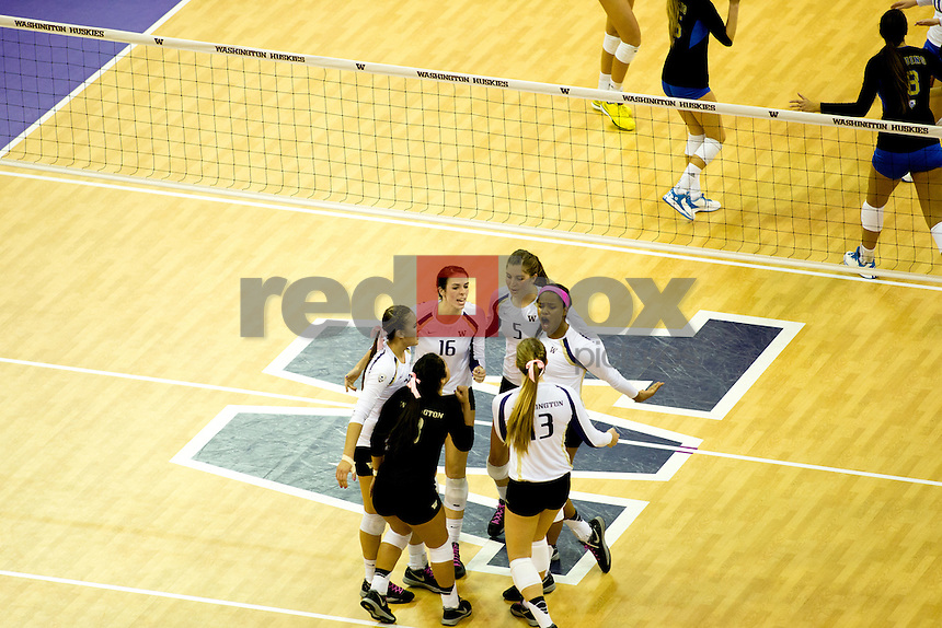 The University of Washington volleyball team defeats UCLA 3-2 on October 3, 2014. (Photography by Scott Eklund/Red Box Pictures)