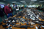 New Jersey, United States. 19th Feb, 2013 -- Media members watch at least 1.700 weapons displayed for the media after being acquired during the Gun Buyback program during the last weekend in the Essex county in New Jersey. Photo by Eduardo Munoz Alvarez / VIEWpress.