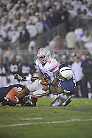 27 October 2012:  Penn State's Glenn Carson (40) and C.J. Olaniyan (86) tackle Ohio State QB Braxton Miller (5). The Ohio State Buckeyes defeated the Penn State Nittany Lions 35-23 at Beaver Stadium in State College, PA.