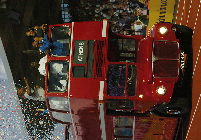 Photo. Henry Browne..Norwich Union London Grand Prix Athletics at Crystal Palace. 30/07/2004..A Big Red London Bus carrying the Great British Athletes.