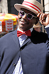 Easter Parade in New York City. Man in a straw hat and a red bowtie on Fifth Avenue in New York City during the Easter Day Parade.