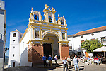 People gather by the baroque church of San Juan at Zahara de la Sierra, Spain Sunday 13 October 2013 after the National Day holiday