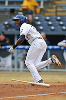 Asheville Tourists first baseman Correlle Prime #32 runs to first during game one of a double header against the West Virginia Power at McCormick Field on April 8, 2014 in Asheville, North Carolina. The Power defeated the Tourists 6-5. (Tony Farlow/Four Seam Images)