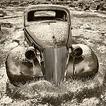Rusty 1930s Pontiac coupe in the ghost town of Bodie, California, State Historic Park.
