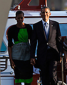 United States President Barack Obama holds hands with first lady Michelle Obama as they walk up the ramp to the entrance of the U.S.S. Arizona Memorial on Thursday, December 29, 2011 in Pearl Harbor, Hawaii.  .Credit: Kent Nishimura / Pool via CNP