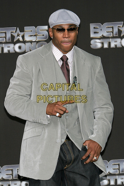 LL COOL J. 25 Strong: The BET Silver 25th Anniversary Special - Press Room held at the Shrine Auditorium, Los Angeles, California..October 26th, 2005.Photo: Zach Lipp/AdMedia/Capital Pictures.half length grey gray suit jacket finger sunglasses shades hat .www.capitalpictures.com.sales@capitalpictures.com.© Capital Pictures.