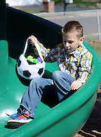 FAIRLESS HILLS, PA - APRIL 12:  Lucas Simicic, 5 of Failress Hills, Pennsylvania glides down  slide after finding Easter eggs during the YMCA Easter Egg Hunt April 12, 2014 in Fairless Hills Pennsylvania. (Photo by William Thomas Cain/Cain Images)