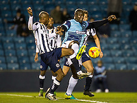 Adebayo Akinfenwa of Wycombe Wanderers during the Checkatrade Trophy round two Southern Section match between Millwall and Wycombe Wanderers at The Den, London, England on the 7th December 2016. Photo by Liam McAvoy.