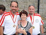Theresa McQuillan pictured with her sons Padraig and Jim of the Oars of hope crew after they rowed from the Isle of Man to Drogheda. Photo: www.colinbellphotos.com