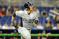 7 March 2012:  FIU catcher Iosmel Leon (13) runs to first base as the Miami Marlins defeated the FIU Golden Panthers, 5-1, at Marlins Park in Miami, Florida.