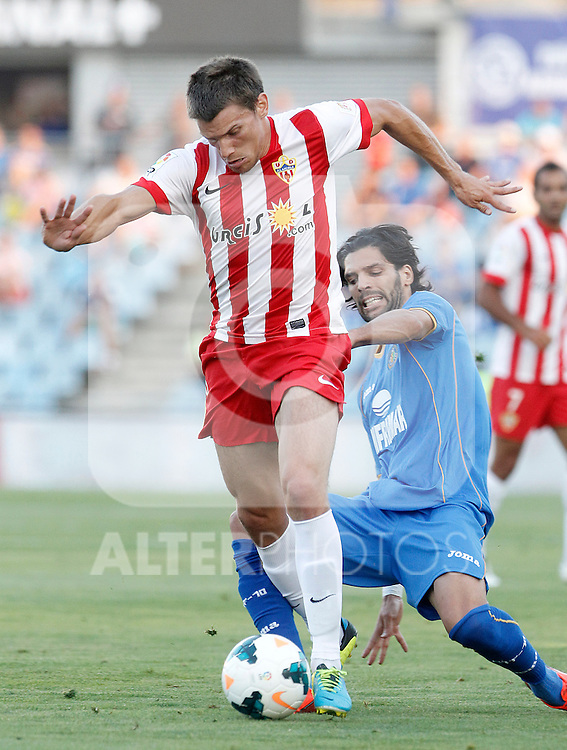 Getafe's Angel Lafita (r) and Almeria's Sebastian Dubarbier during La Liga match.August 23,2013. (ALTERPHOTOS/Acero)