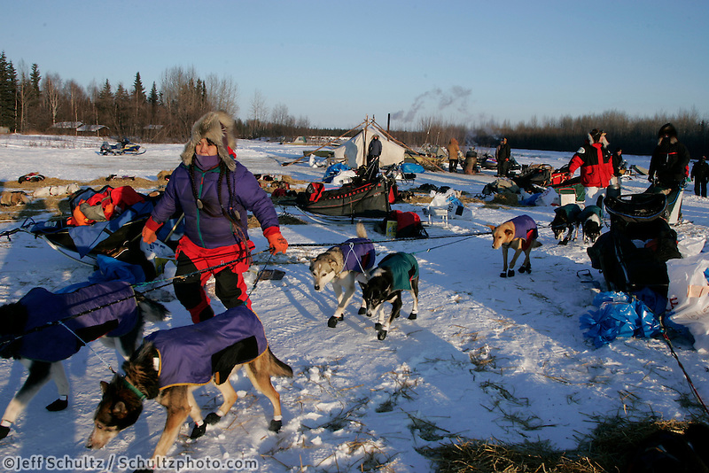 Tuesday March 6, 2007   Volunteer Marty Runkle leads Sonny Lindner's dogs to a parking spot at the Nikolai checkpoint on Tuesday