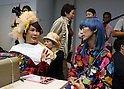 "October 19, 2016, Tokyo, Japan - Japanese transgender actress Ai Haruna (L) chats with designer Takafumi Tsuruta as they prepare for the ""tenbo"" 2017 spring/summer collection as a part of Japan Fashion Week in Tokyo on Wednesday, October 19, 2016.   (Photo by Yoshio Tsunoda/AFLO) LWX -ytd-"