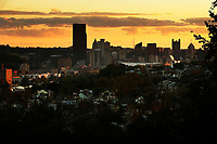 The sun sets over the downtown Pittsburgh skyline on Tuesday October 23, 2018 in Pittsburgh, Pennsylvania. (Photo by Jared Wickerham/City Paper)