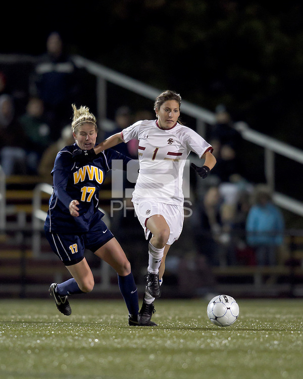 "Boston College forward Victoria DiMartino (1) dribbles as West Virginia forward Erica Henderson (17) defends. Boston College defeated West Virginia, 4-0, in NCAA tournament ""Sweet 16"" match at Newton Soccer Field, Newton, MA."