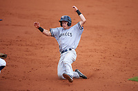 Tampa Yankees second baseman Nick Solak (39) slides into third base during the first game of a doubleheader against the Charlotte Stone Crabs on July 18, 2017 at Charlotte Sports Park in Port Charlotte, Florida.  Charlotte defeated Tampa 7-0 in a game that was originally started on June 29th but called to inclement weather.  (Mike Janes/Four Seam Images)