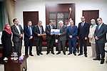 Palestinian President Mahmoud Abbas receives the annual report of the Financial and Administrative Management Bureau, in the West Bank city of Ramallah on June 13, 2017. Photo by Osama Falah