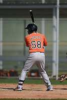 Second baseman Yariel Vargas (58) of the Baltimore Orioles organization during a minor league spring training camp day game on March 23, 2014 at Buck O'Neil Complex in Sarasota, Florida.  (Mike Janes/Four Seam Images)