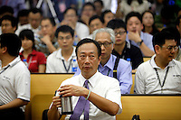 Terry Gou, founder and chairman of Hon Hai Group, attends a news conference at the company's Foxconn plant in Shenzhen, China, on Wednesday, May 26, 2010. Hon Hai is the parts supplier for many hi-tech companies around the world including Apple Inc., Hewlett-Packard Co. and Dell Inc. There have been 12 suicides at the company's 300 thousand employee strong factory complex in Shenzhen so far this year.