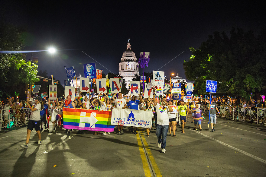 AUSTIN, TEXAS - Members of the Travis County Democratic Party holding Hillary Clinton signs for president, walk in the Austin PRIDE 2016, the annual gay pride parade, as it makes its way through downtown Saturday, Aug. 27, 2016. <br />