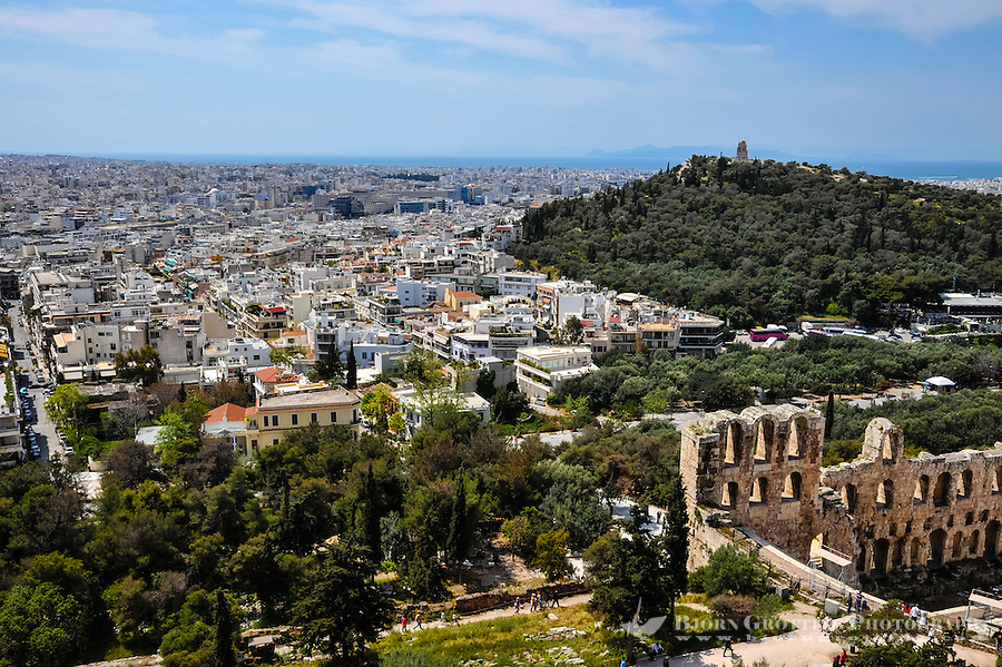Greece, Athens. View of Athens. The Odeon of Herodes Atticus is a stone theatre on the slopes of Acropolis.