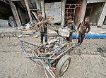 Boys scavenge recyclable metal and plastic from rubble in the old city of Mosul, Iraq. This portion of the city was heavily damaged in 2016 and 2017 when Iraqi forces, supported by U.S. air strikes, combated Islamic State fighters who held residents of the old city as human shields.